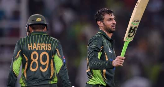 PROMISING: Shoaib Malik celebrates scoring a century against Zimbabwe in Lahore