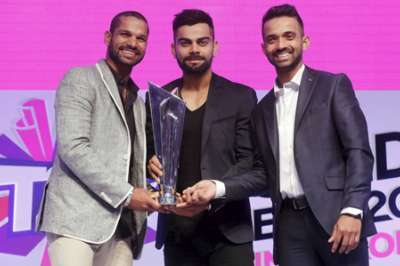 SCHEDULE: (From left) Indian cricket stars Shikhar Dhawan, Virat Kohli and Ajinkya Rahane with the World Cup trophy